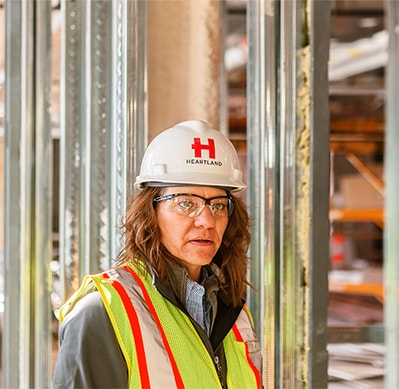 Image of Heartland Companies employee wearing branded hardhat