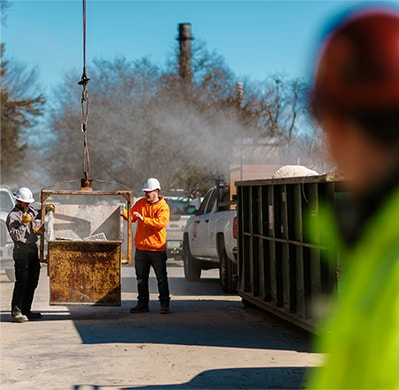 Image of Heartland Companies employees cleaning up with industrial equipment
