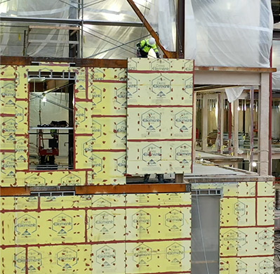 Image of Heartland Companies employee Installation of prefabricated panels for external walls