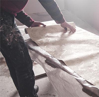 Image of Heartland employee preparing Wall Coverings