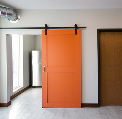 Example of a barn style door done by Heartland Companies