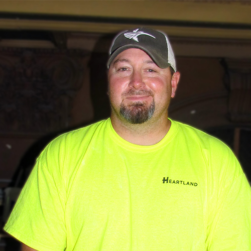 Color Color image of Aaron Benton, a Plasterer within Heartland's Field Family