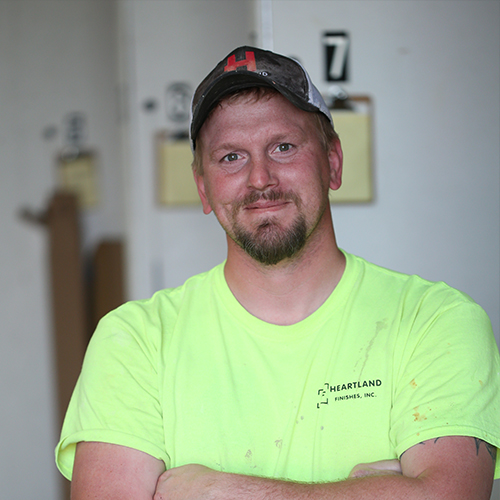 Color Image of Adam Benton, a Plasterer within Heartland's Field Family