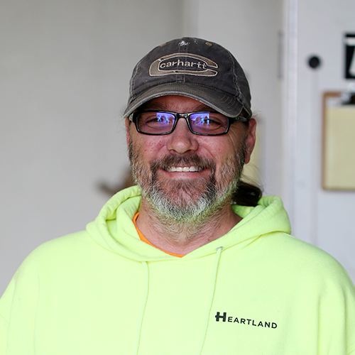 Color image of Tim Chessel, a Plasterer within Heartland's Field Family